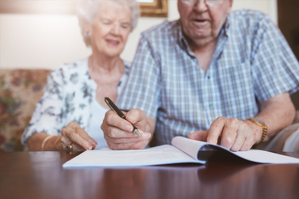 Elderly couple signing their will